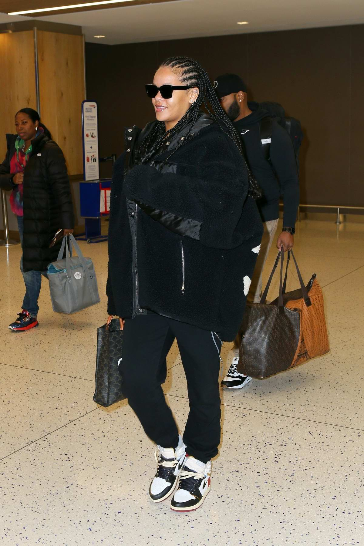 Rihanna looks trendy in all-black ensemble as she arrives at JFK airport in New York City