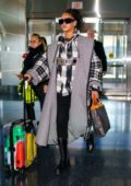 Rihanna makes a stylish arrival at JFK Airport in New York City
