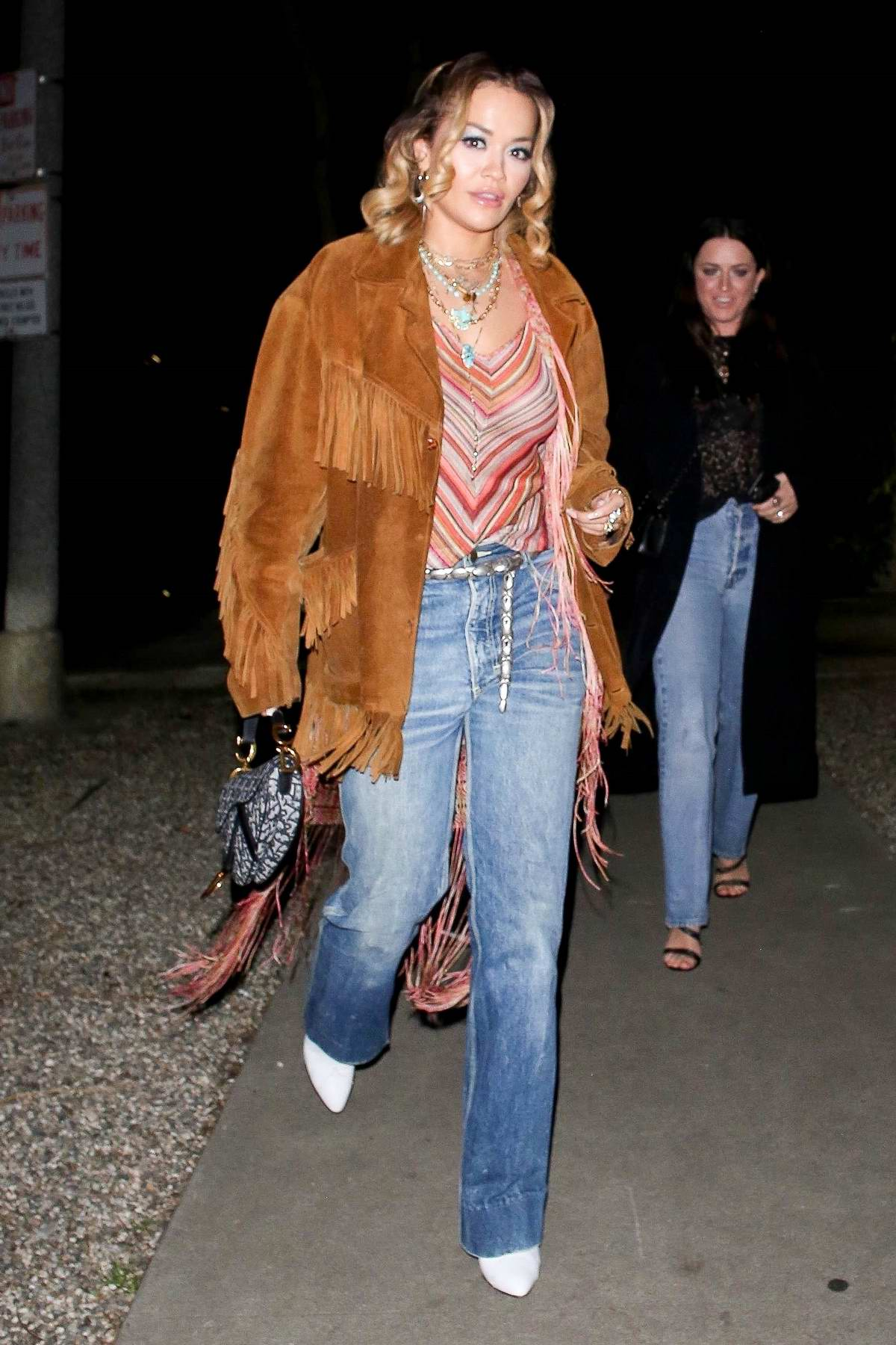 Rita Ora rocks a fringe jacket as she steps out with friends for dinner in Los Feliz, California
