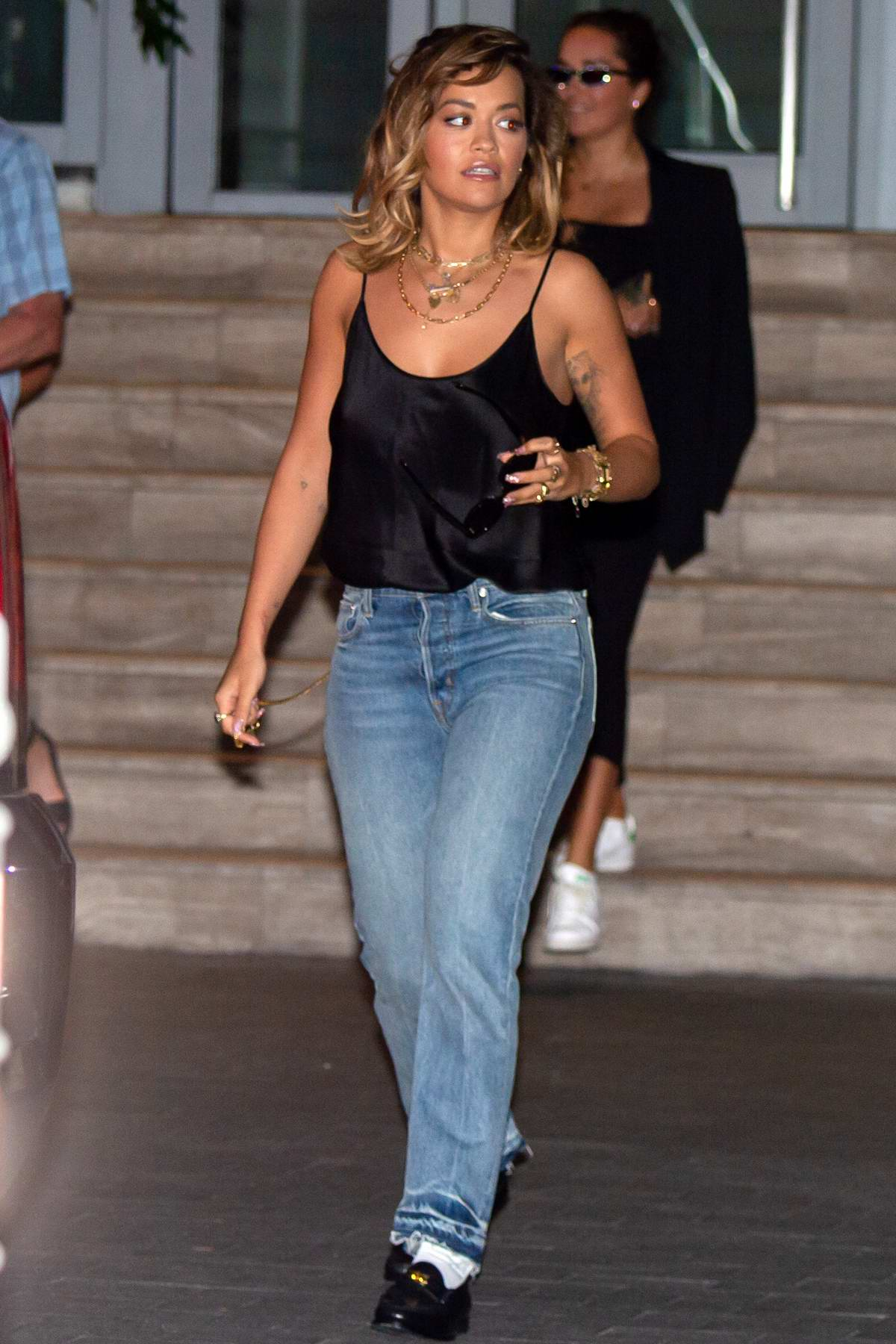 Rita Ora wears a black satin camisole as she leaves her hotel in Miami Beach, Florida