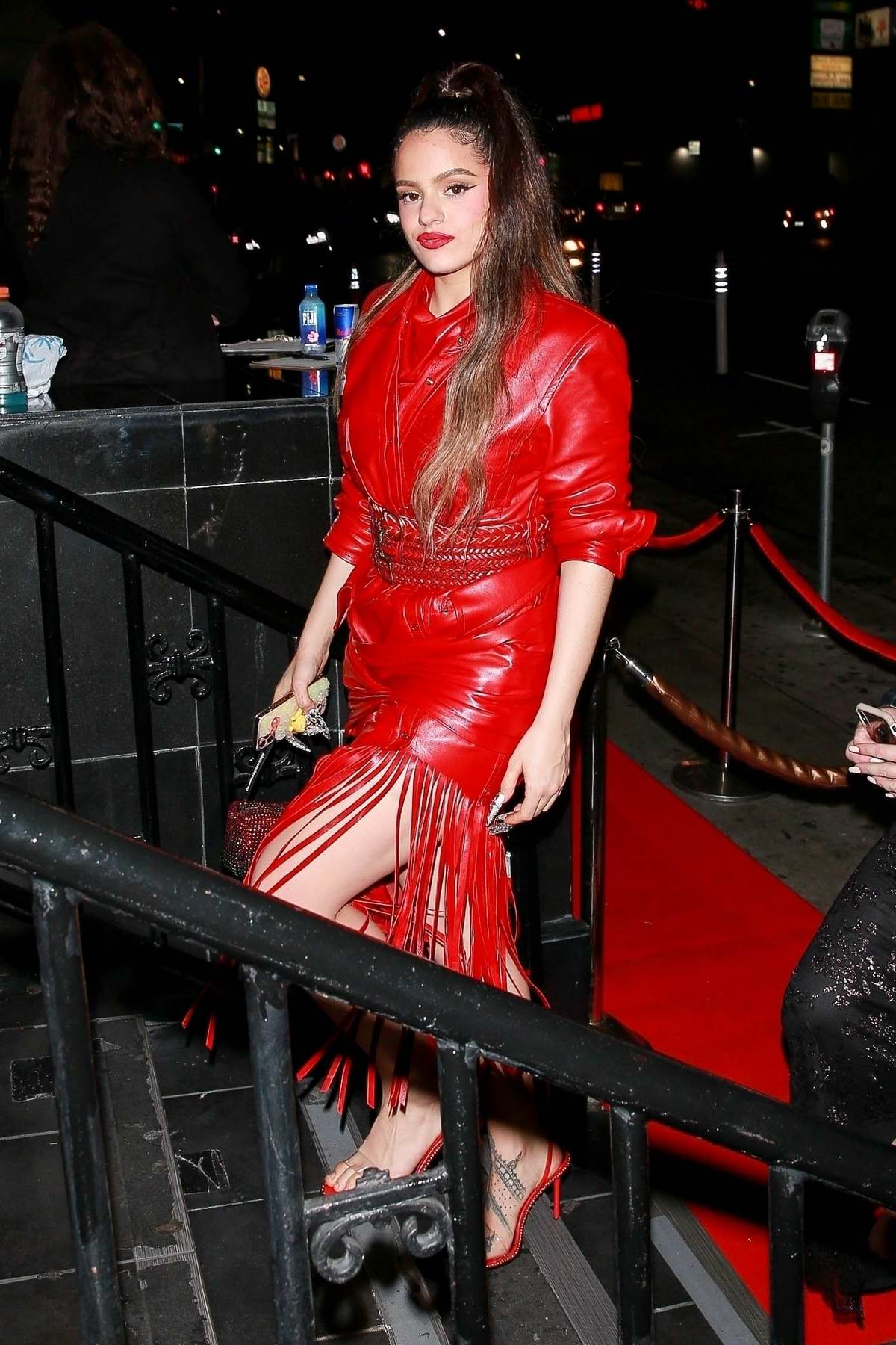 Rosalía stands out in bright red as she arrives at Lizzo's Grammy After-Party in Los Angeles