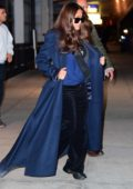 Salma Hayek looks great in a blue long coat as she touches down at JFK airport in New York City