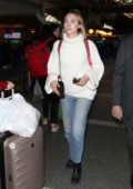 Saoirse Ronan wears a white turtleneck and jeans as she jets out of LAX airport in Los Angeles