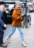 Scarlett Johansson bundles up as she arrives for a press junket at a hotel in New York City