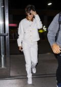 Selena Gomez dons all-white denim as she arrives at JFK airport in New York City