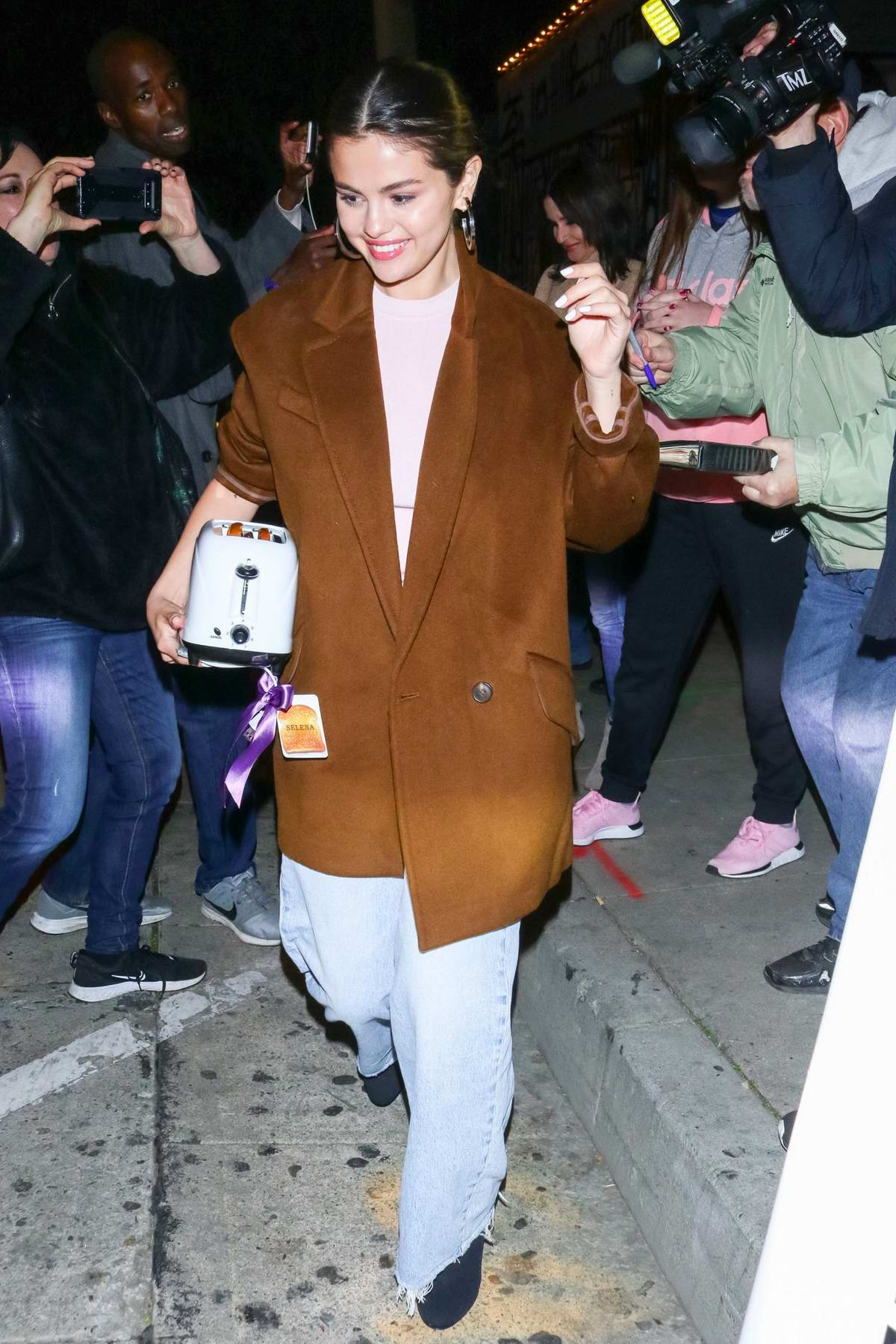 Selena Gomez is all smiles as she leaves Craig's in West Hollywood, California
