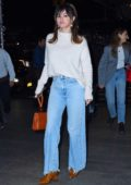 Selena Gomez looks cute in a fuzzy white sweater and denim while out for dinner at Nobu in New York City