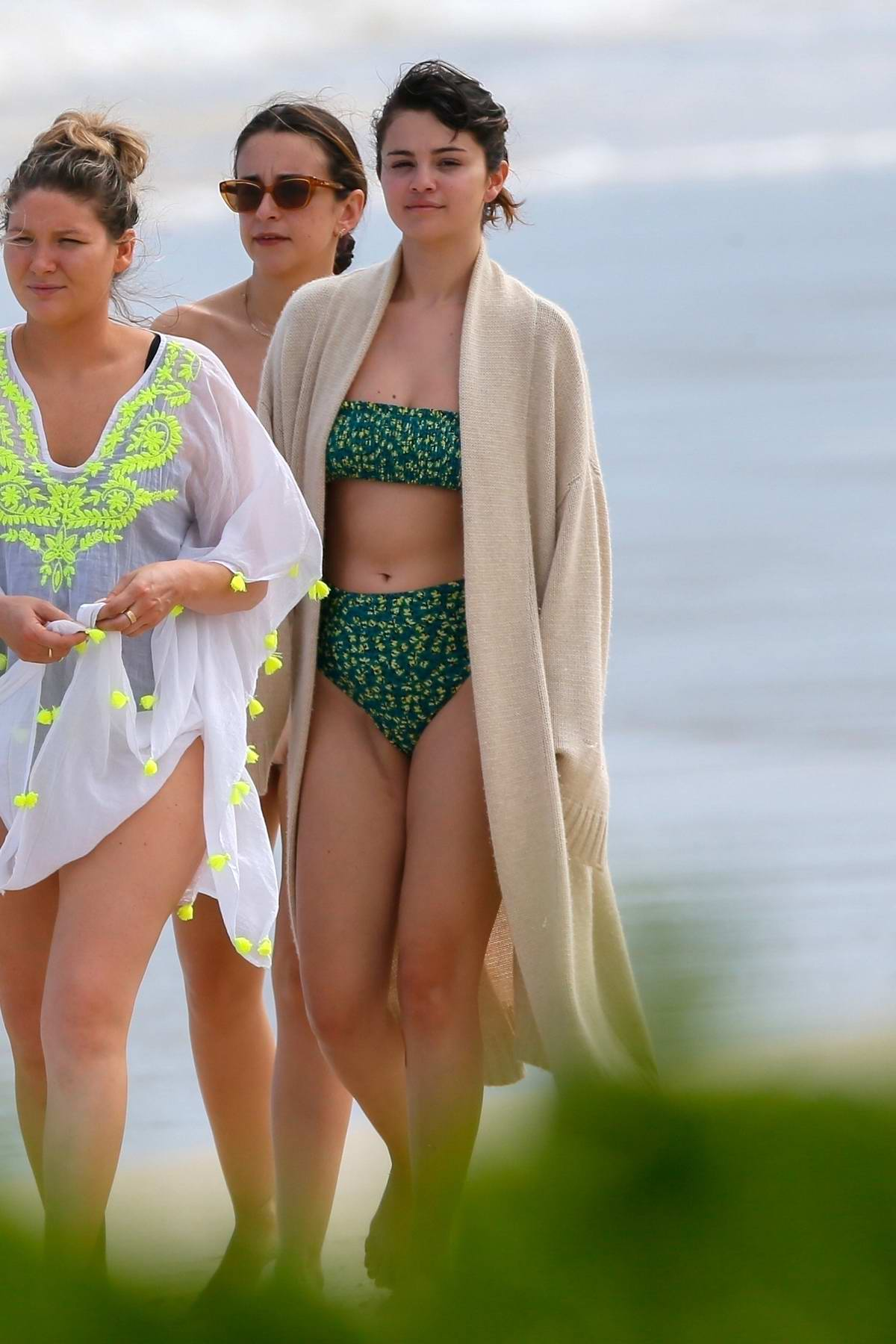 Selena Gomez seen wearing a green bikini while at the beach with friends in Honolulu, Hawaii