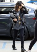 Selena Gomez sports black leather jacket and leggings as she arrives at Nine Zero One Salon in West Hollywood, California