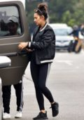 Shay Mitchell wears a black bomber jacket and Adidas leggings while out running errands in Los Feliz, California