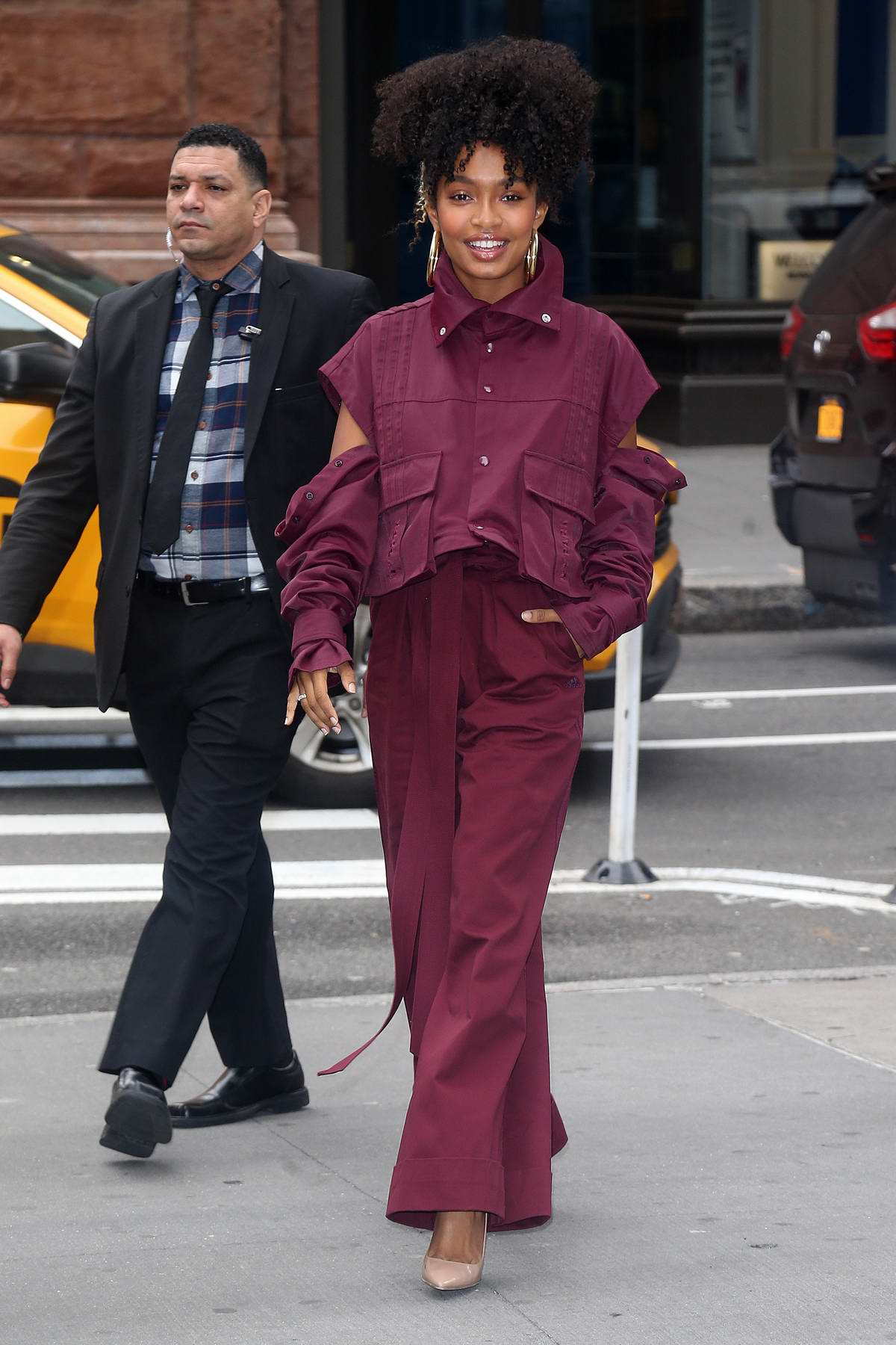 Yara Shahidi seen wearing an all-maroon outfit as she visits the Build Series in New York City
