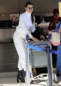 Adriana Lima looks great in all-white as she arrives for a flight out of LAX Airport in Los Angeles