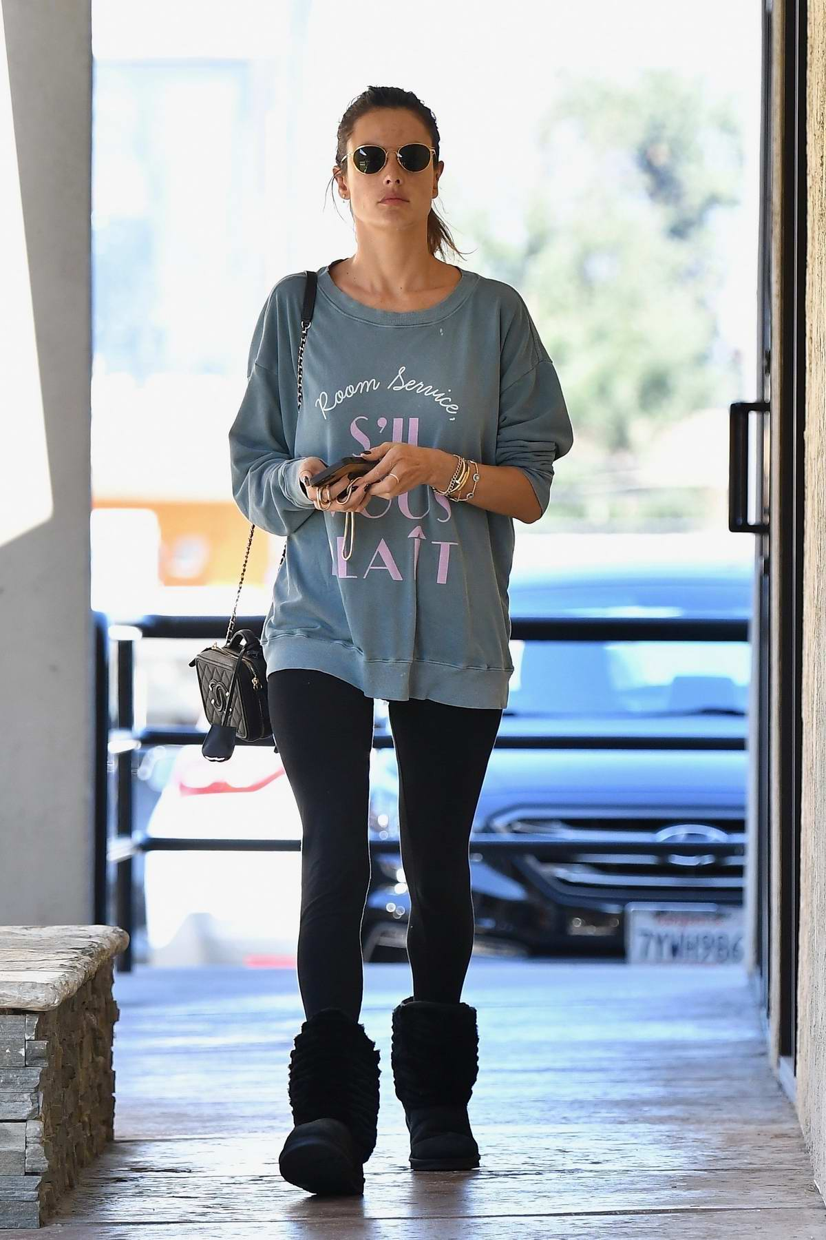 Alessandra Ambrosio looks busy on her phone while visiting a day spa in Los Angeles