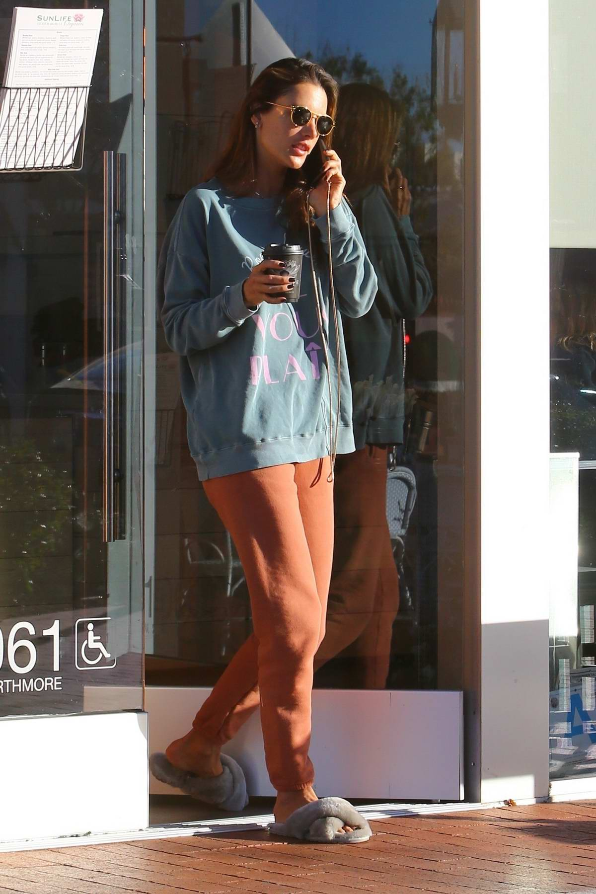 Alessandra Ambrosio looks comfy in sweats while out out for a coffee at Sunlife Organics in Pacific Palisades, California