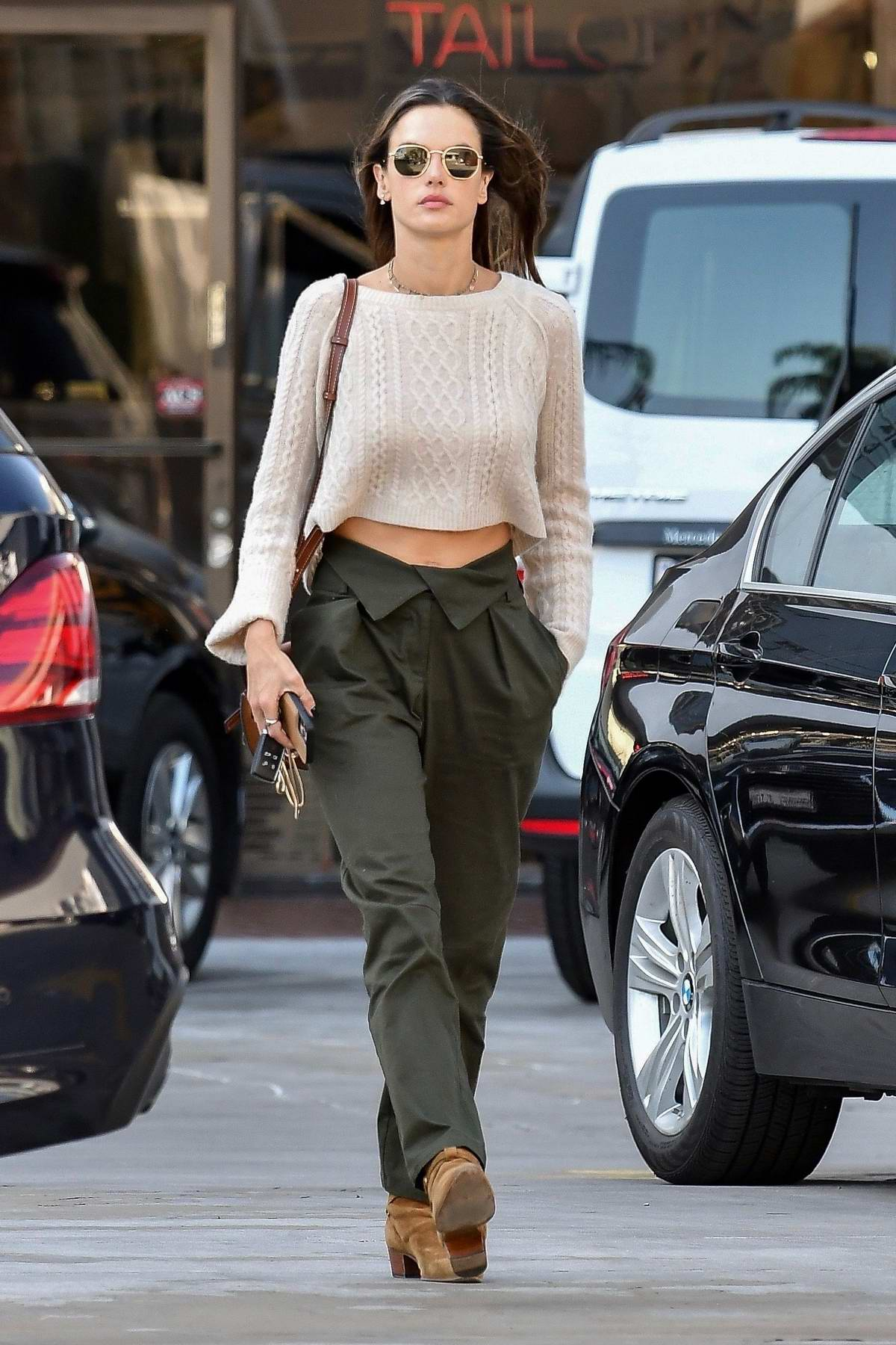 Alessandra Ambrosio looks stunning in a cropped beige sweater while out running errands in Santa Monica, California