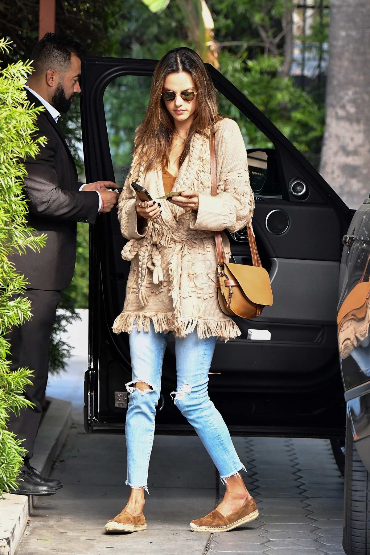 Alessandra Ambrosio looks stylish in a beige knitted coat as she arrives for a meeting in Beverly Hills, California