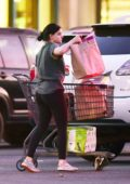 Ariel Winter wears a t-shirt and leggings while stocking up on party supplies in Los Angeles