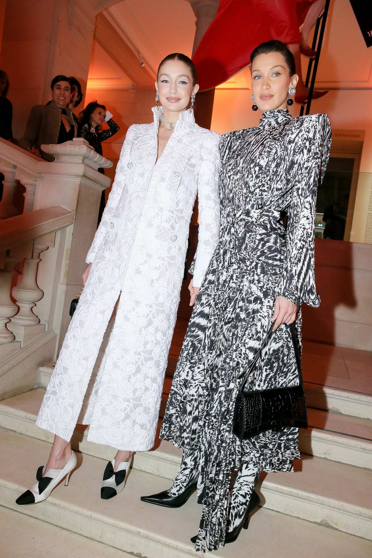 Bella Hadid and Gigi Hadid attend the Harper's Bazaar gala during Paris Fashion Week 2020 in Paris, France