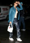 Bella Hadid dons dragon print denim and a teal leather coat while out in New York City