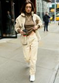Bella Hadid looks trendy in a jacket over her brown top and khakis while stepping out during NYFW 2020 in New York City