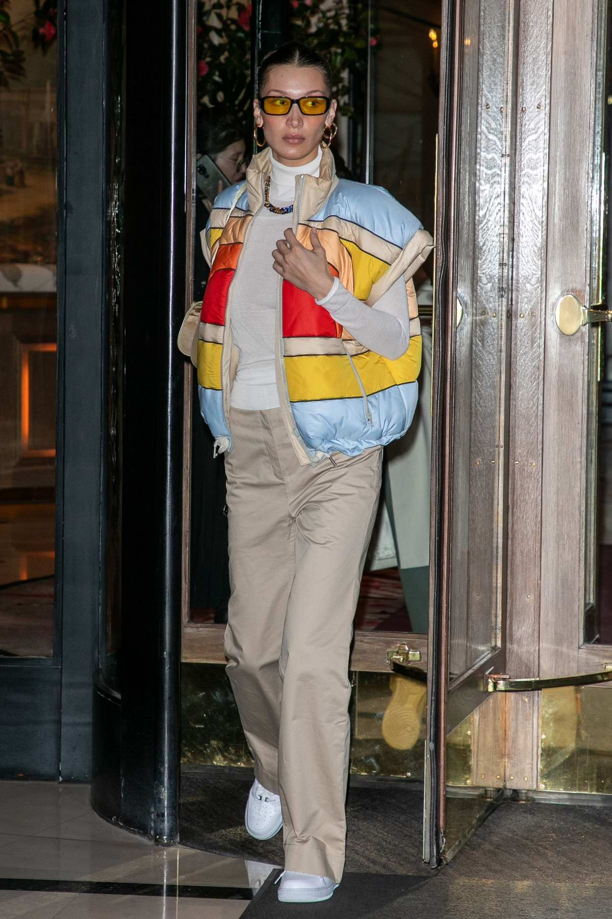 Bella Hadid sports a multi-colored jacket as she steps out during Paris Fashion Week in Paris, France