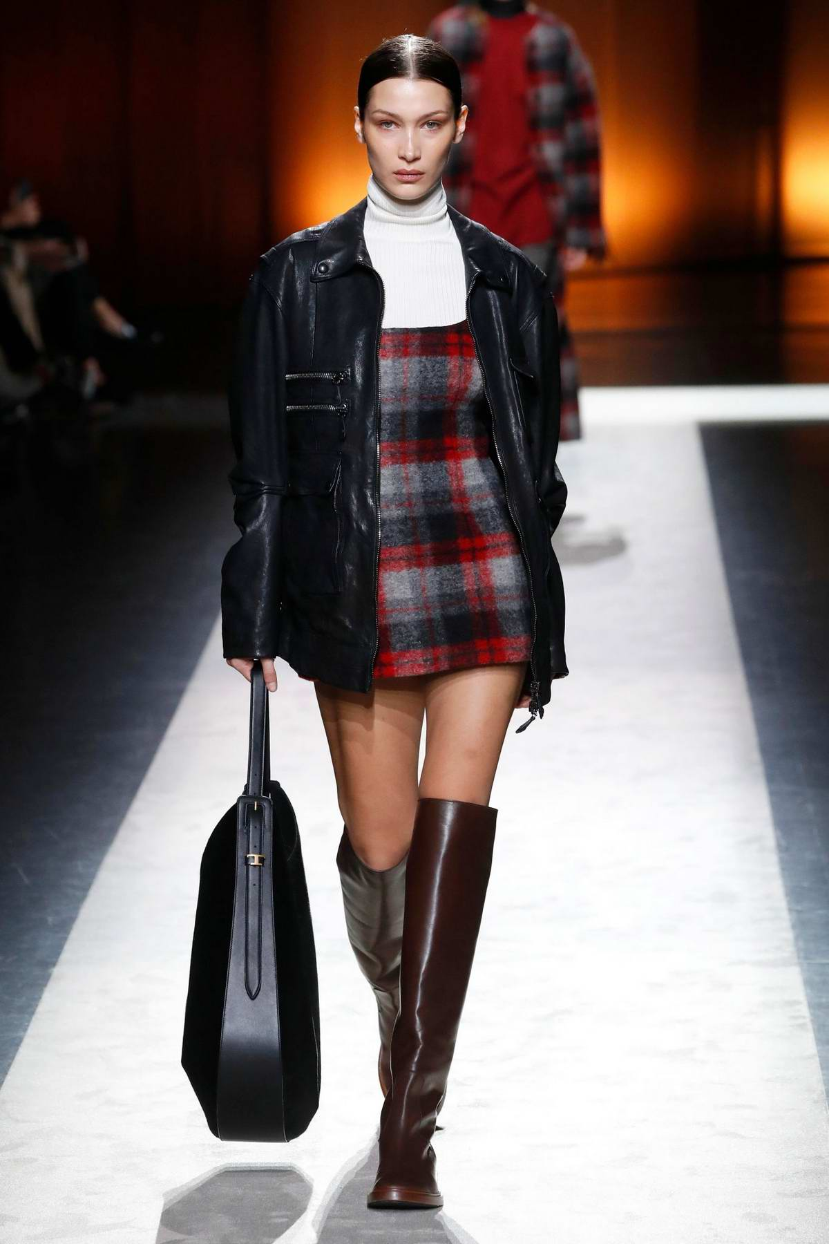 Bella Hadid walks the runway at the Tod's fashion show, F/W 2020 during Milan Fashion Week in Milan, Italy