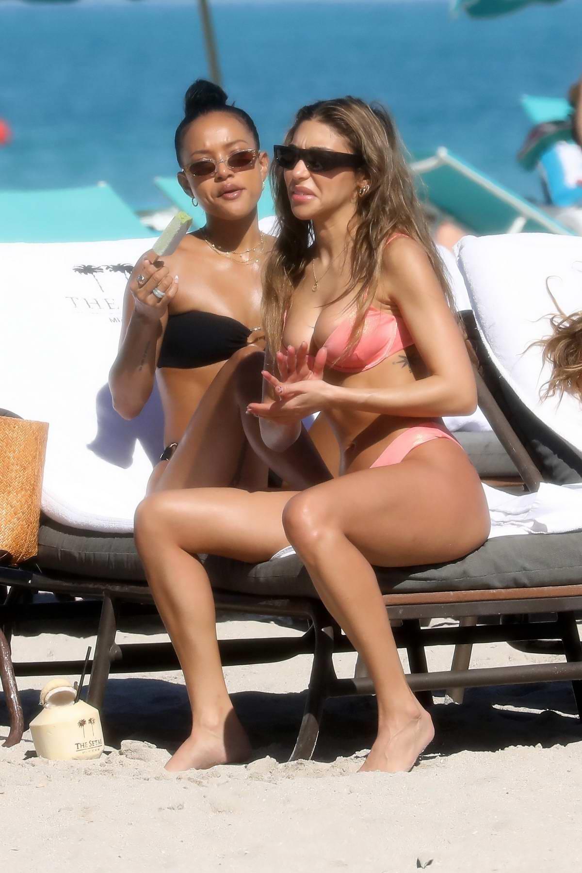 Chantel Jeffries and Karrueche Tran slip into their bikinis while enjoying a beach day in Miami, Florida