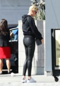Charlize Theron seen wearing a black hoodie and leather pants as she leaves lunch at Sugarfish in Los Angeles