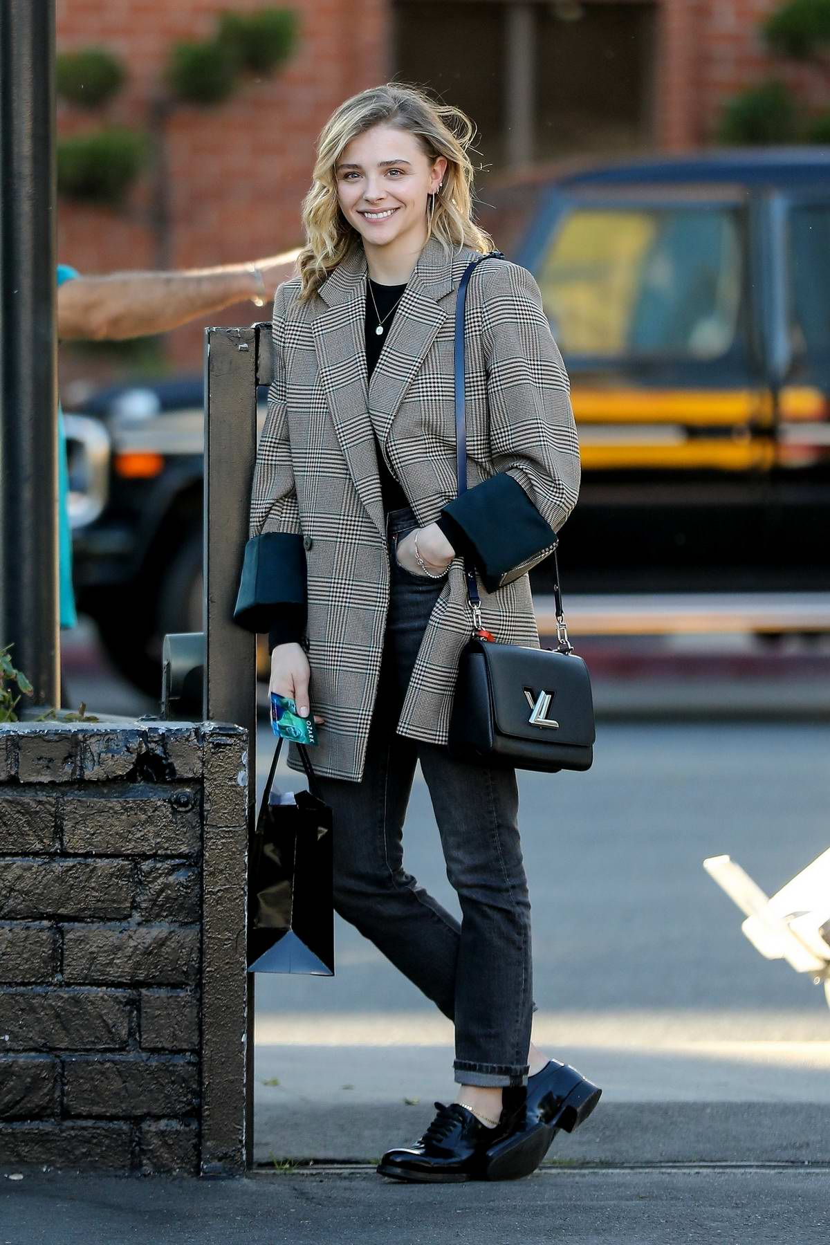 Chloe Grace Moretz is all smiles during a shopping trip to XIV Karats in Beverly Hills, California
