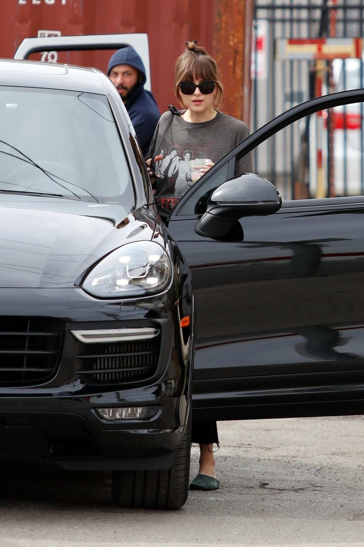 Dakota Johnson keeps it casual in a tee and jeans for her salon visit in Los Angeles