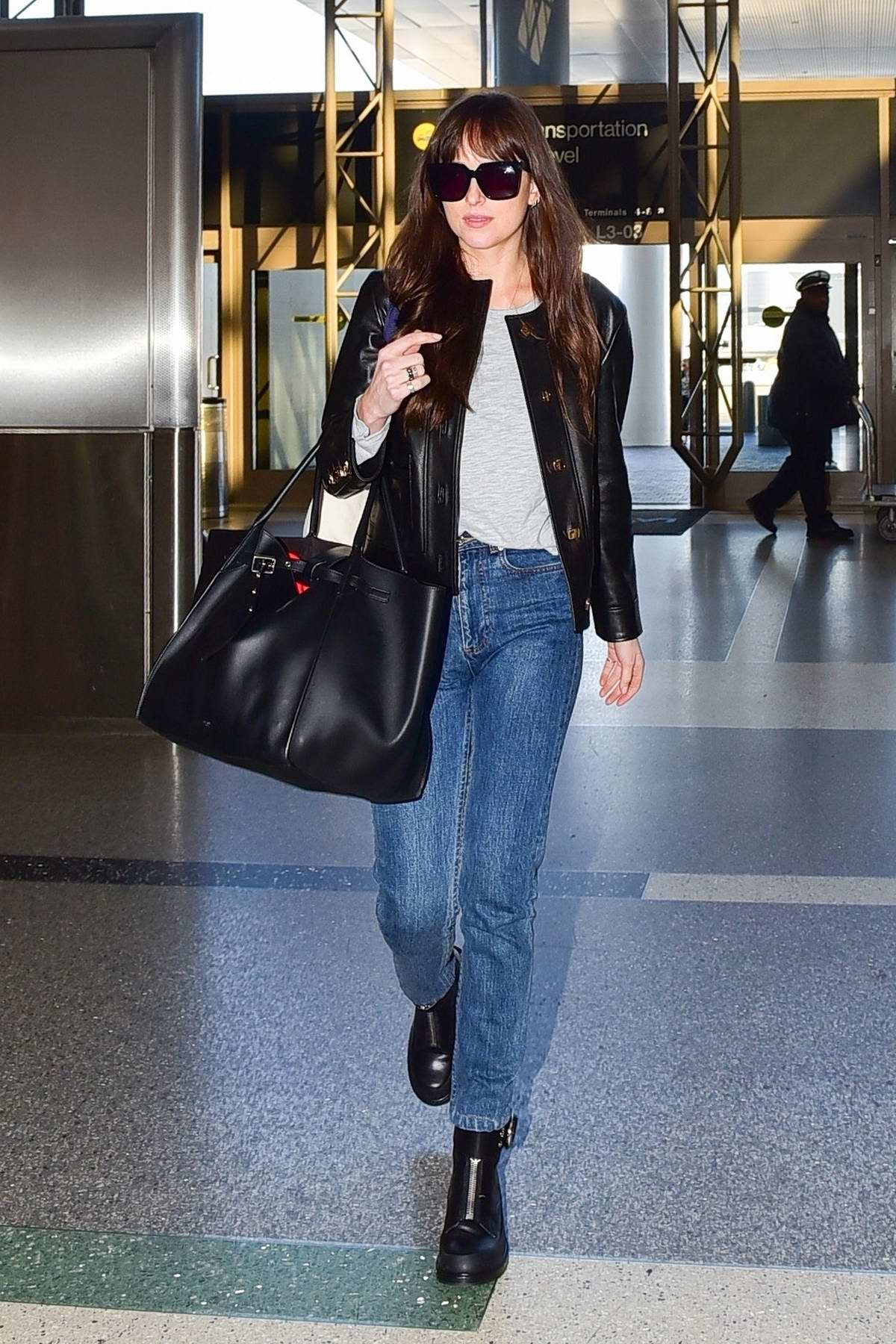Dakota Johnson seen at the airport on Valentine's Day as she arrives to catch a flight out of LAX in Los Angeles