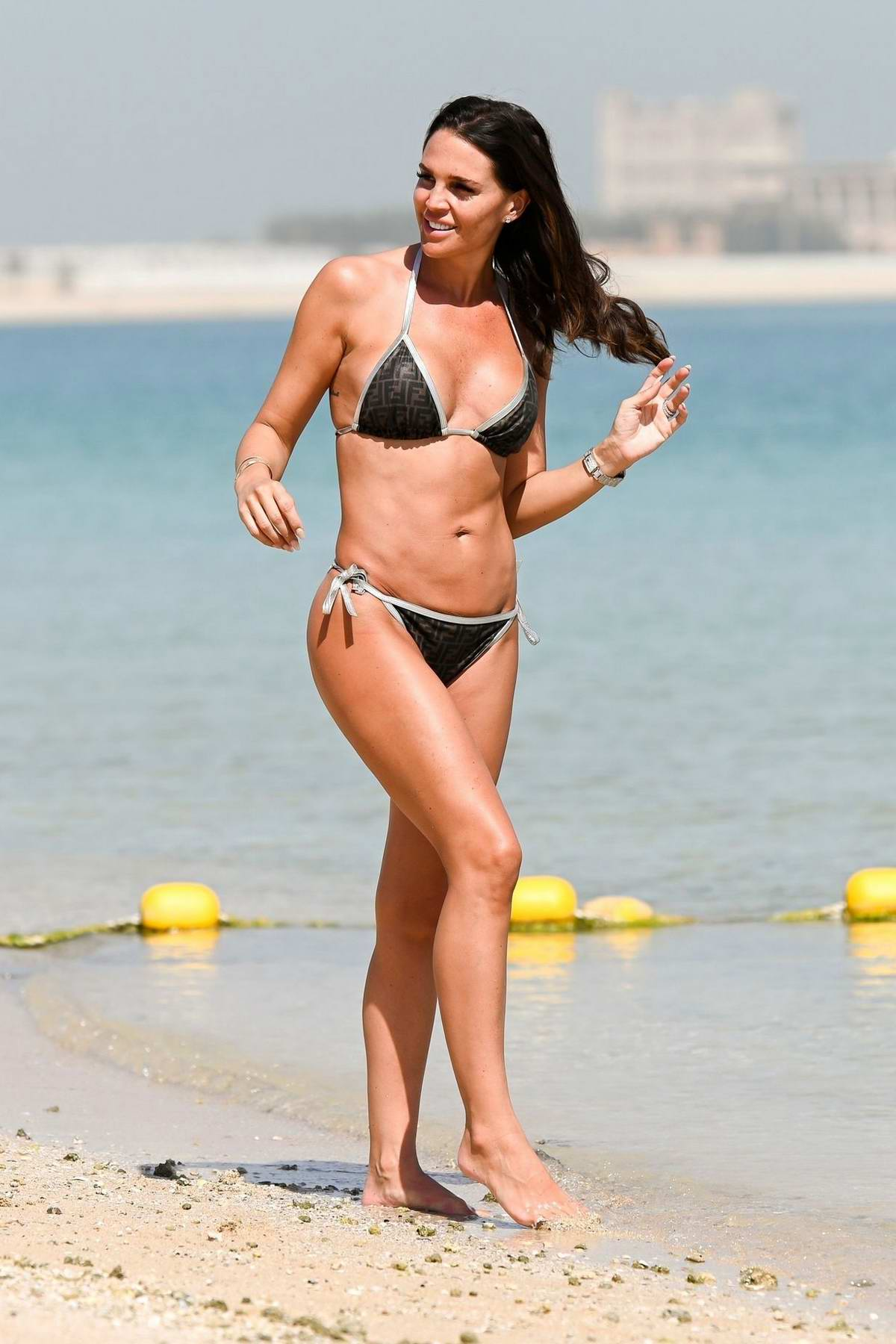 Danielle Lloyd wears a Fendi bikini as she takes a shower after a dip in the sea in Dubai, UAE