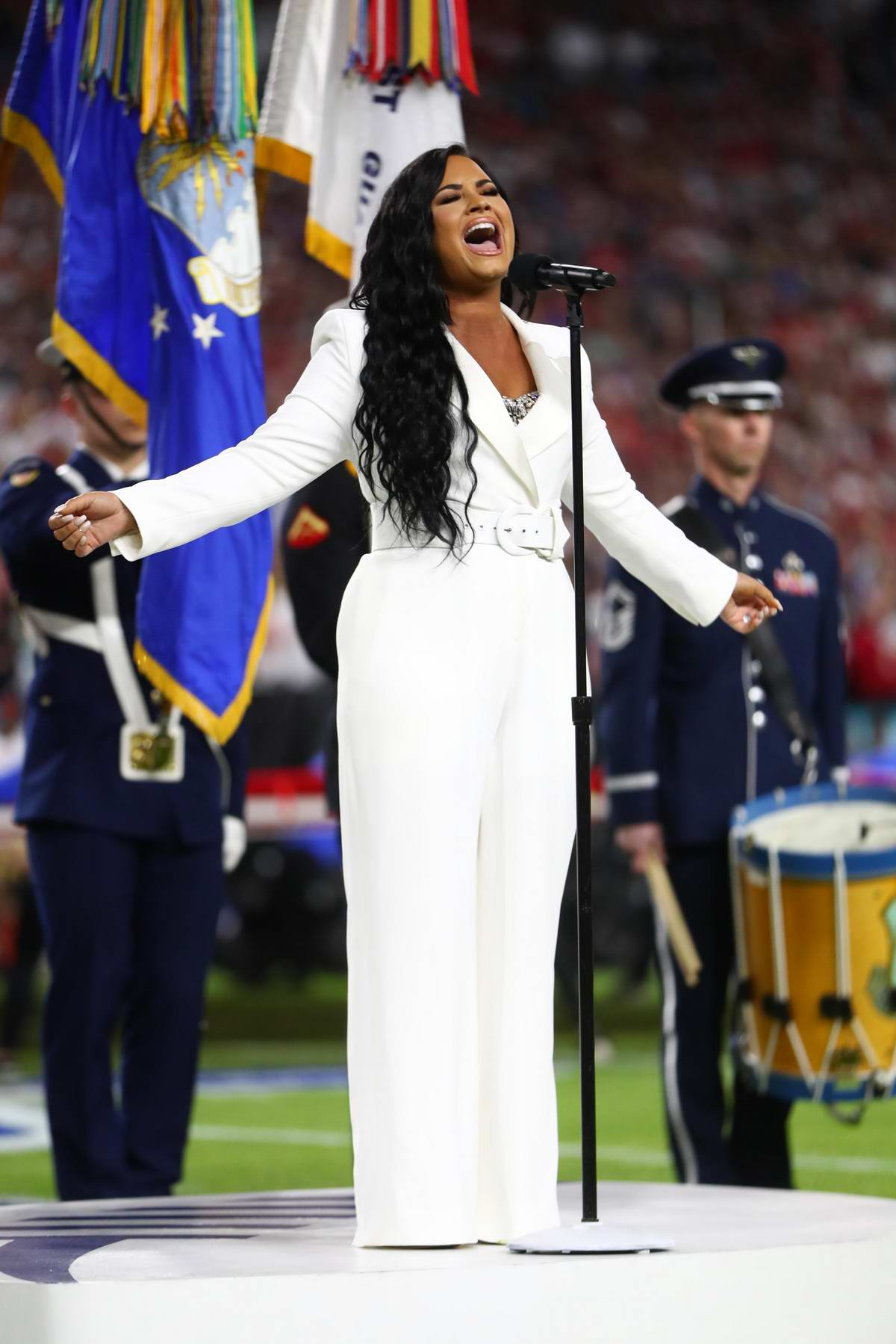 Demi Lovato sings the US National Anthem during Super Bowl LIV in Miami, Florida