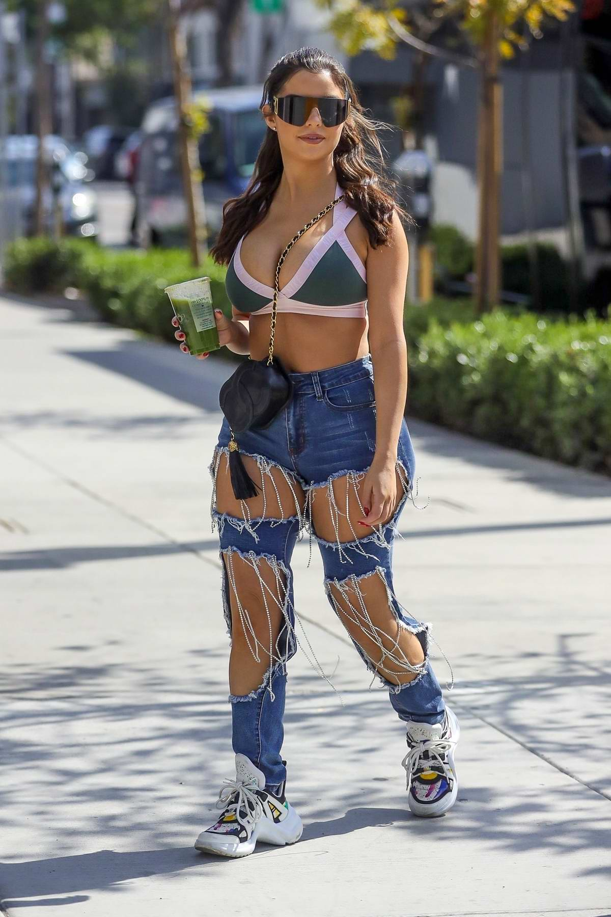 Demi Rose flaunts her curves while out shopping with a friend on Melrose Place in Los Angeles