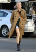 Diane Kruger wears a trench coat and denim shorts while out running errands with Norman Reedus in Los Angeles