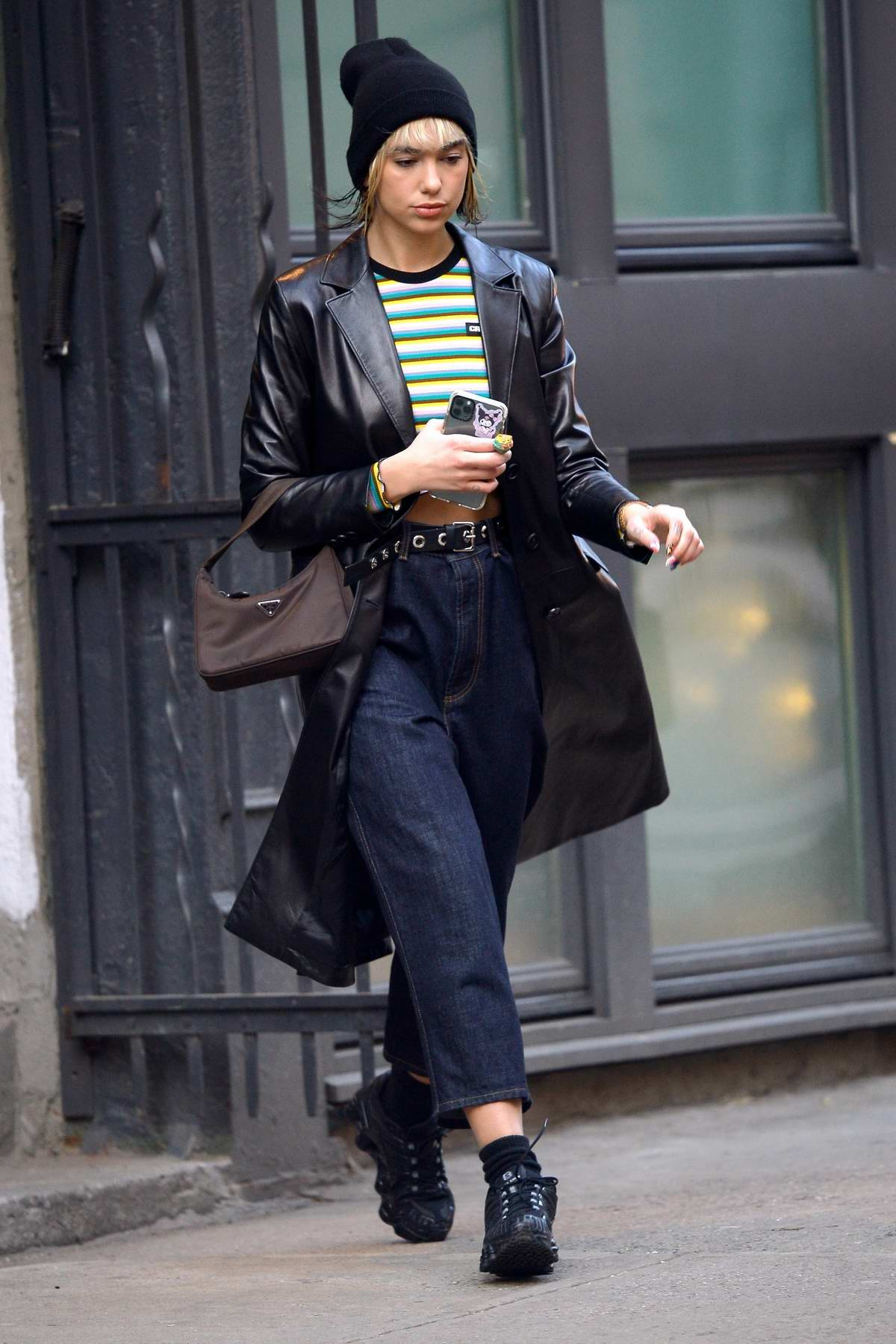 Dua Lipa shows off her cool street-style as she leaves her apartment in New York City