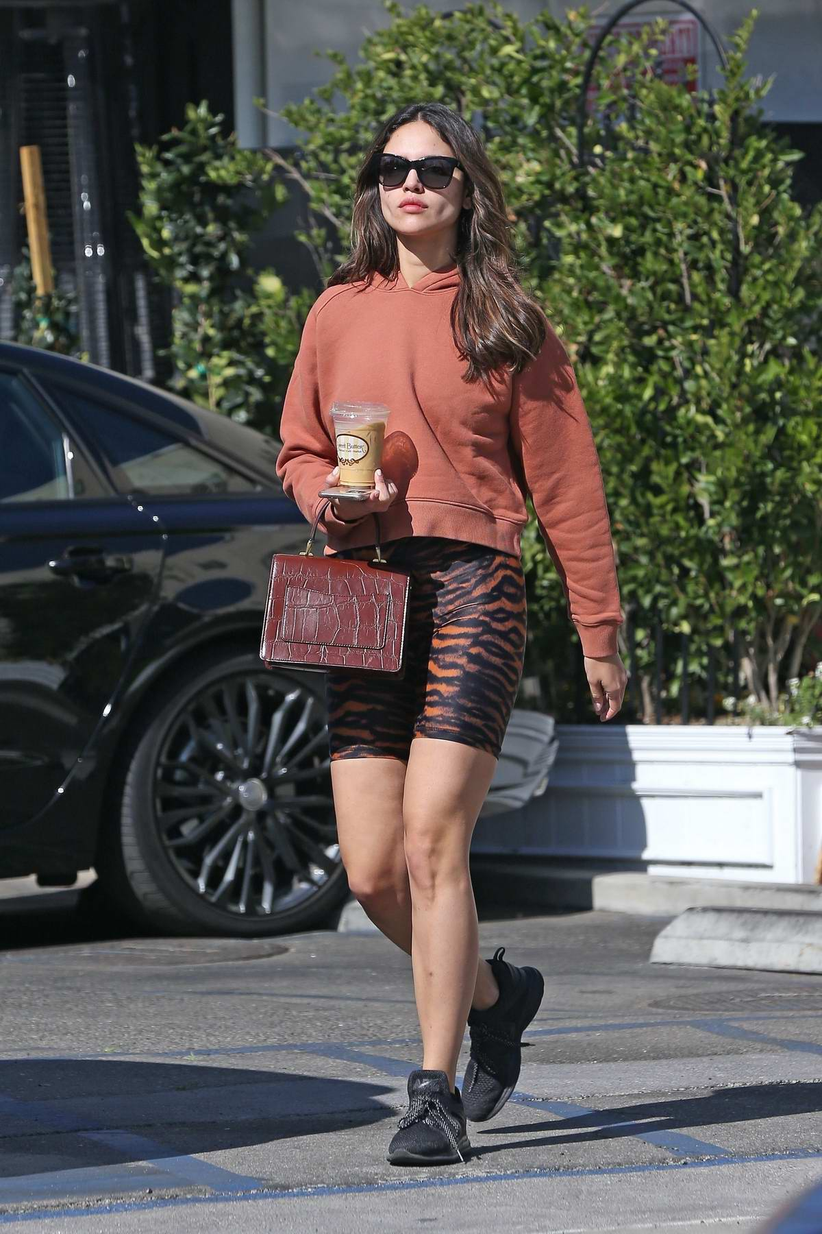 Eiza Gonzalez looks trendy in tiger stripes bike shorts while out grabbing food at Sweet Butter Kitchen in Studio City, California