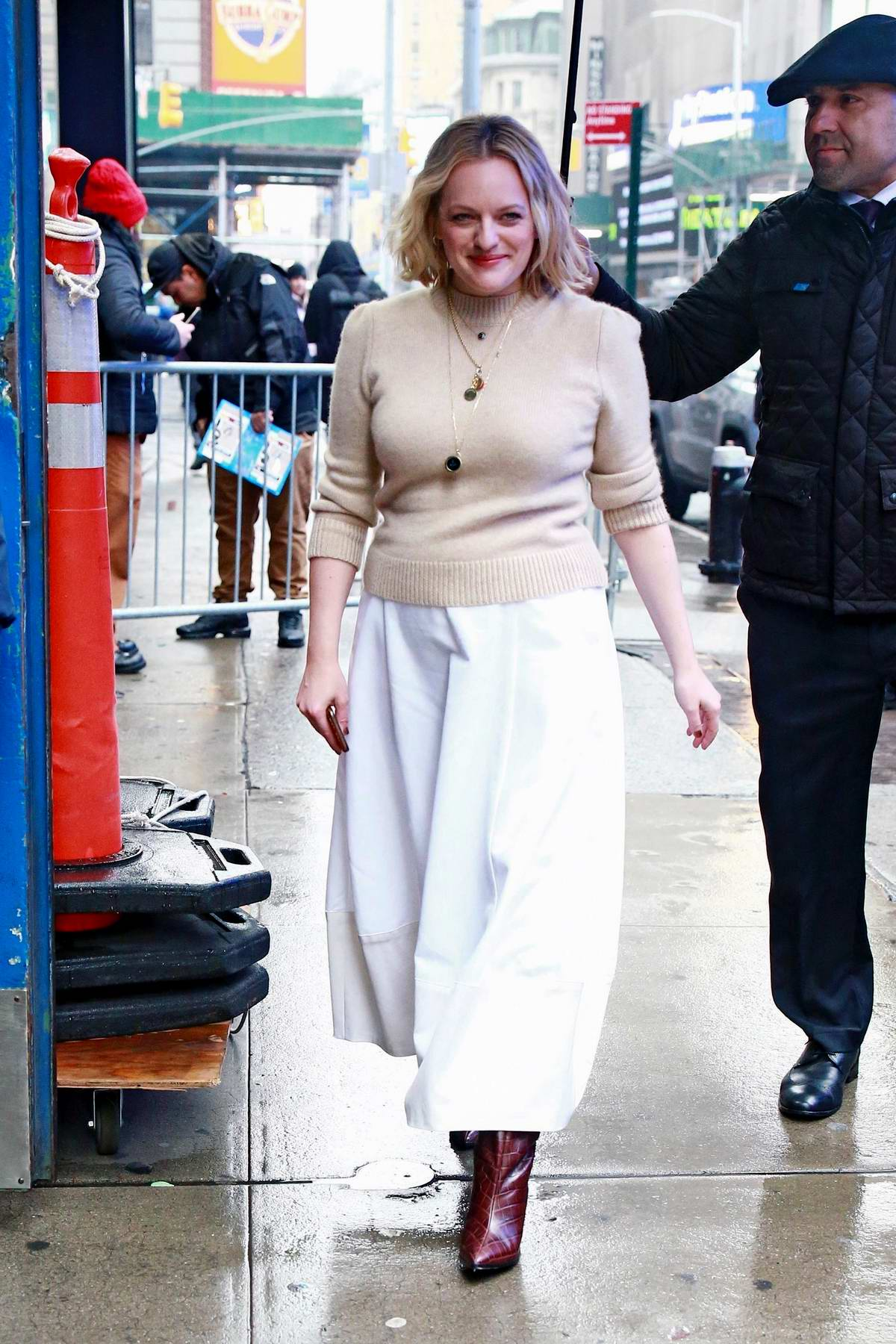 Elisabeth Moss braves the rain while visiting 'Good Morning America' in New York City