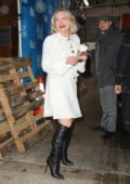 Elisabeth Moss seen wearing a white short dress and black boots while promoting the 'Invisible Man' in New York City