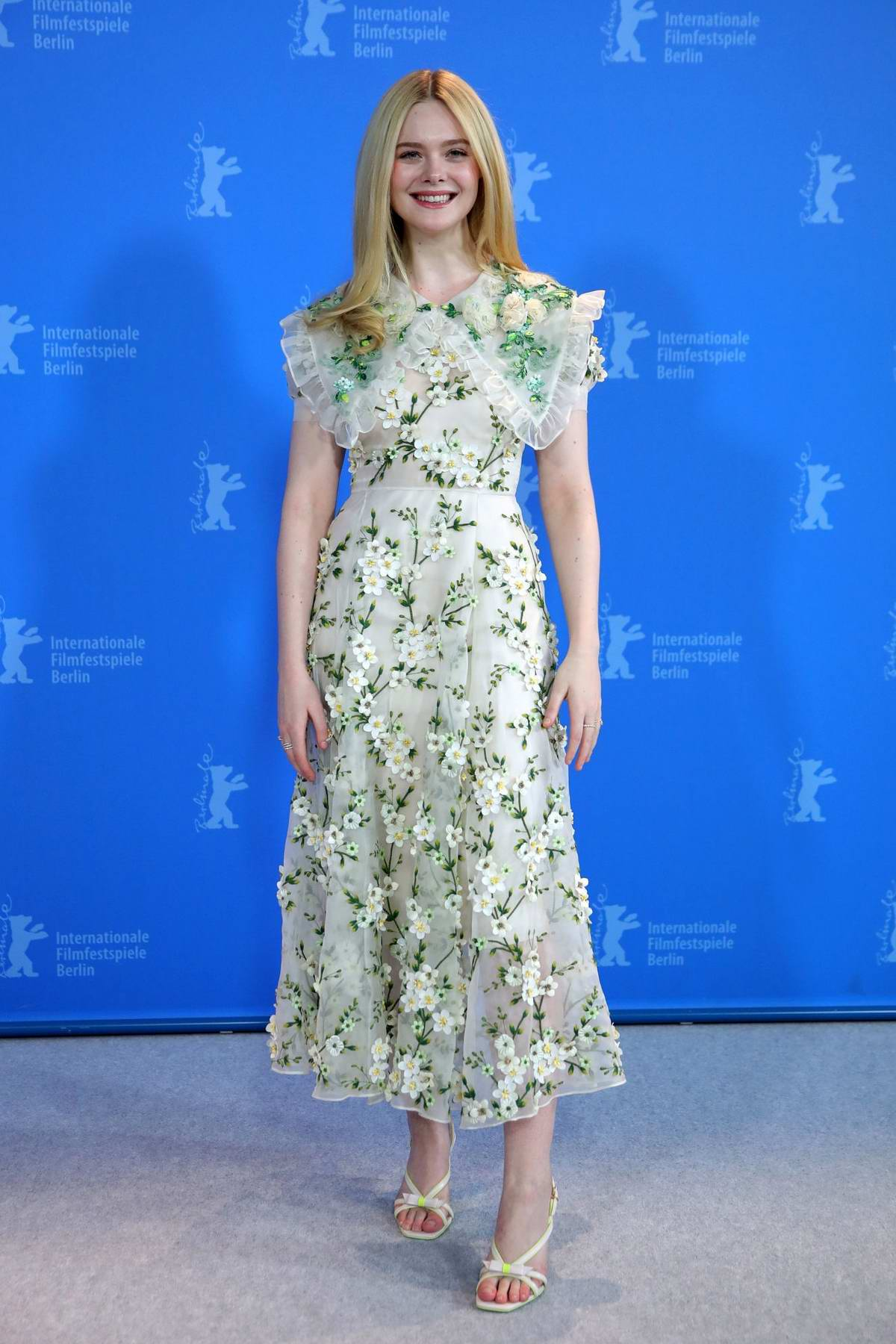 Elle Fanning attends a photocall and press conference for 'The Roads Not Taken' during 70th Berlinale film festival in Berlin, Germany