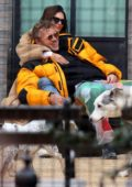 Emily Ratajkowski cuddles with Sebastian Bear-McClard while sharing a romantic moment at a dog park in New York City
