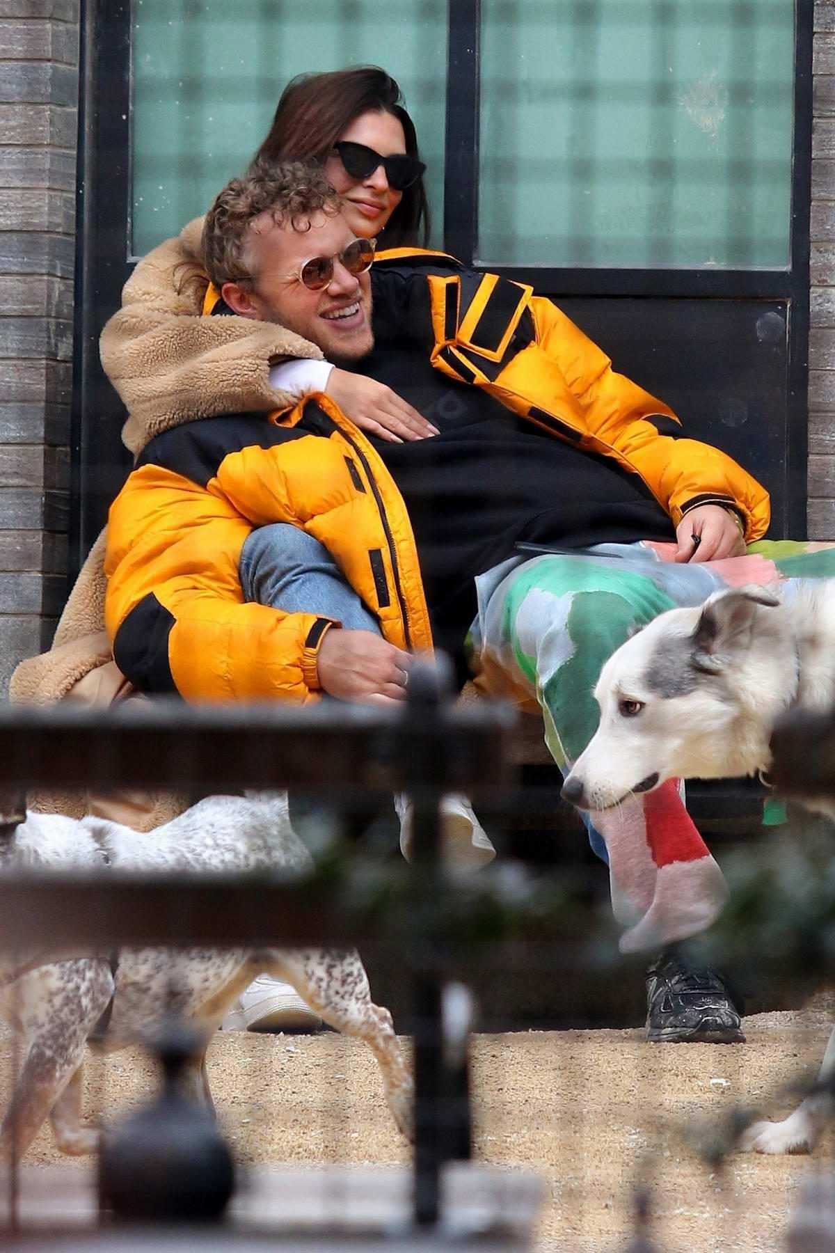 Emily Ratajkowski cuddles with Sebastian Bear-McClard while sharing a romantic moment at a dog park in New York City