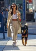 Emily Ratajkowski looks stylish in a crop top and trench coat as she steps out for her morning coffee in New York City