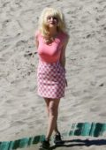 Emmy Rossum spotted in a huge blonde wig while filming scenes for 'Angelyne' on the beach in Malibu, California