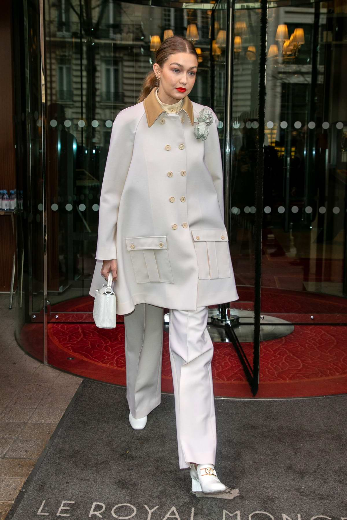 Gigi Hadid is fashionable in white while heading out to a fitting during Paris Fashion Week 2020 in Paris, France