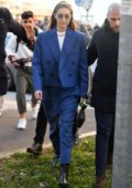 Gigi Hadid keeps it chic in a blue suit as she arrives at the Prada show during Milan Fashion Week in Milan, Italy