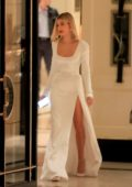 Hailey Bieber looks amazing in a white long slit gown as she the London Hotel in West Hollywood, California
