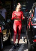 Hailey Bieber looks fab in a red crop top and matching leggings as she grabs a post-workout at Earthbar in Los Angeles