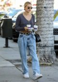 Hailey Bieber shows off her midriff in a cropped sweater while making a coffee run in Beverly Hills, California