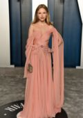 Halston Sage attends the 2020 Vanity Fair Oscar Party at Wallis Annenberg Center for the Performing Arts in Los Angeles